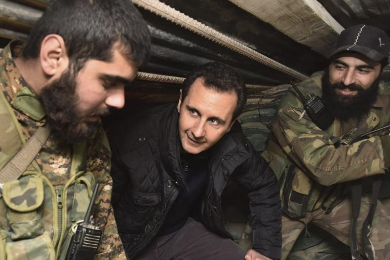 456195-syrian-president-bashar-al-assad-c-talks-to-soldiers-during-a-visit-to
