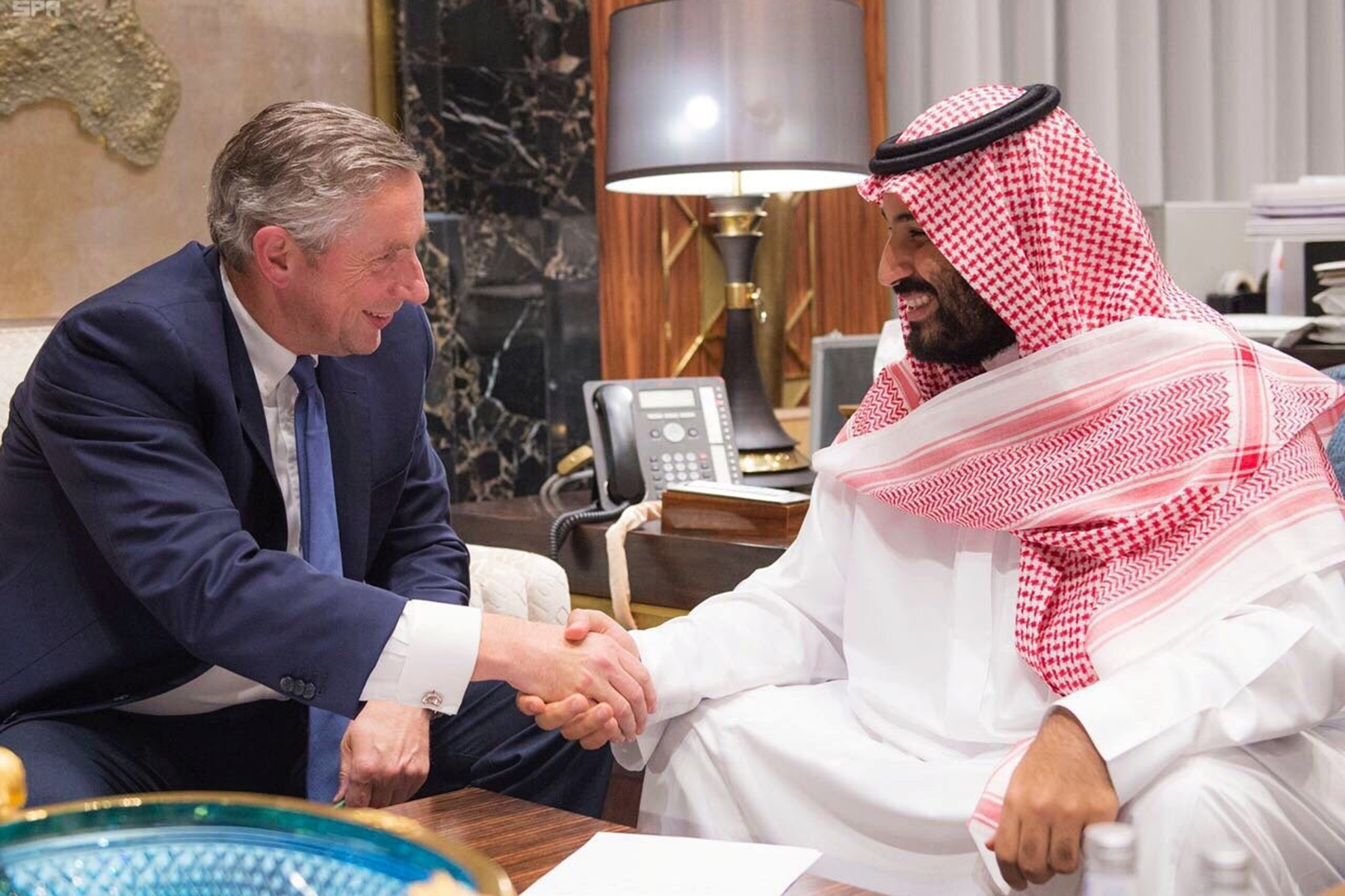 Saudi Crown Prince Mohammed bin Salman shakes hands with Klaus Kleinfeld after Kleinfeld was appointed as NEOM's Chief Executive Officer, in Riyadh