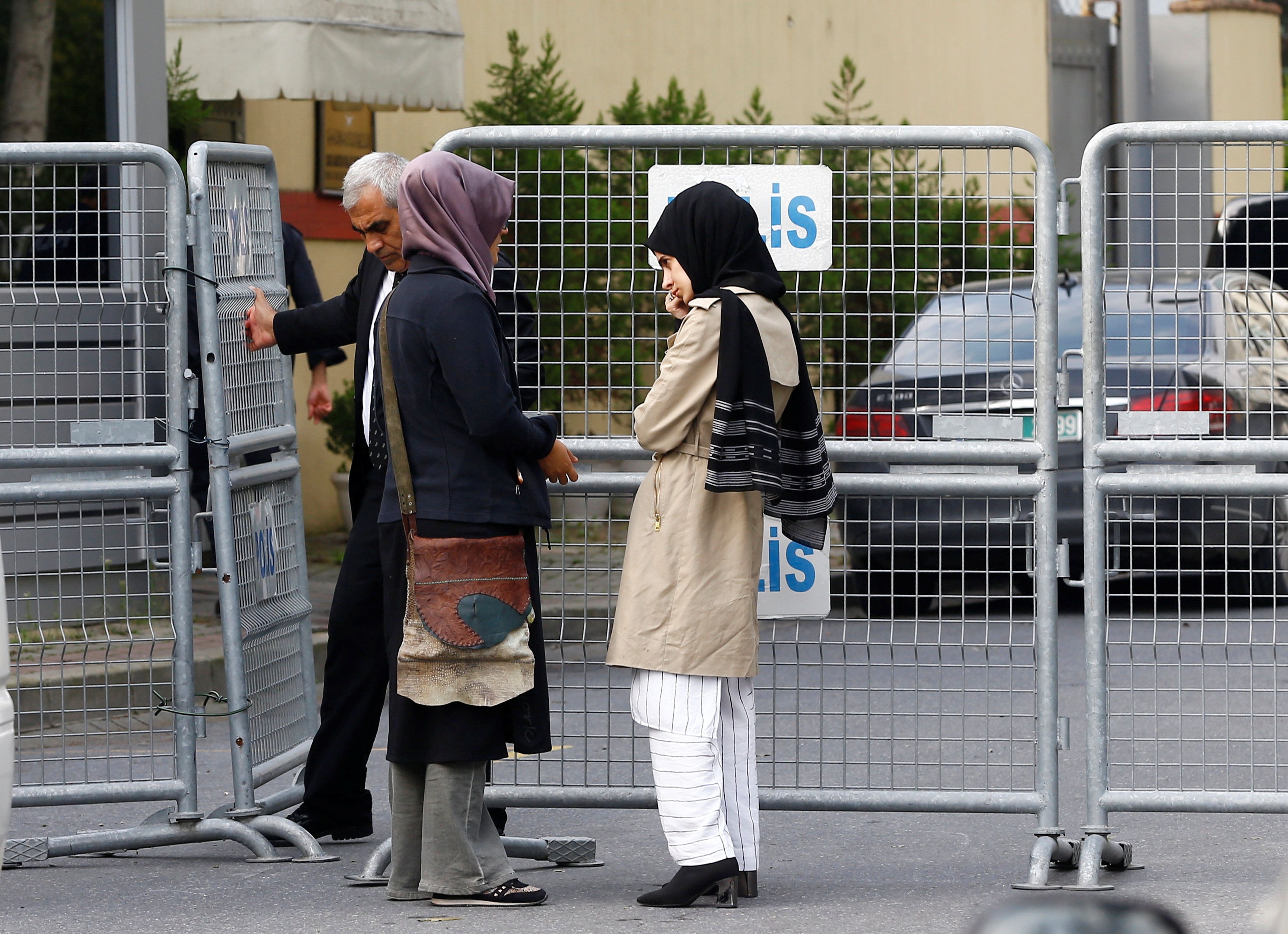 Fiancee of Saudi journalist Jamal Khashoggi and her friend wait outside Saudi Arabia's consulate in Istanbul
