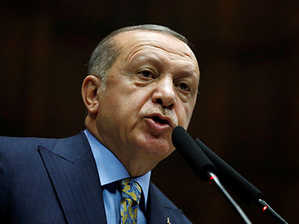 Turkish President Erdogan addresses members of parliament from his ruling AK Party during a meeting at the Turkish parliament in Ankara
