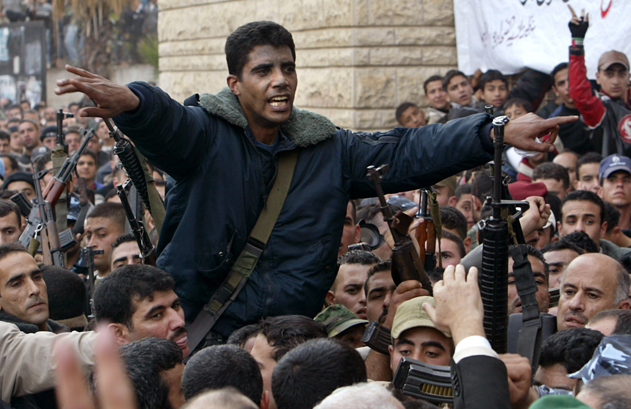 West Bank commander of the militant Al Aqsa Martyrs Brigades Zakaria Zubeid is carried on the …