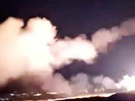 A still image from a video footage shows surface to air missiles being launched into air by Syrian military in Homs