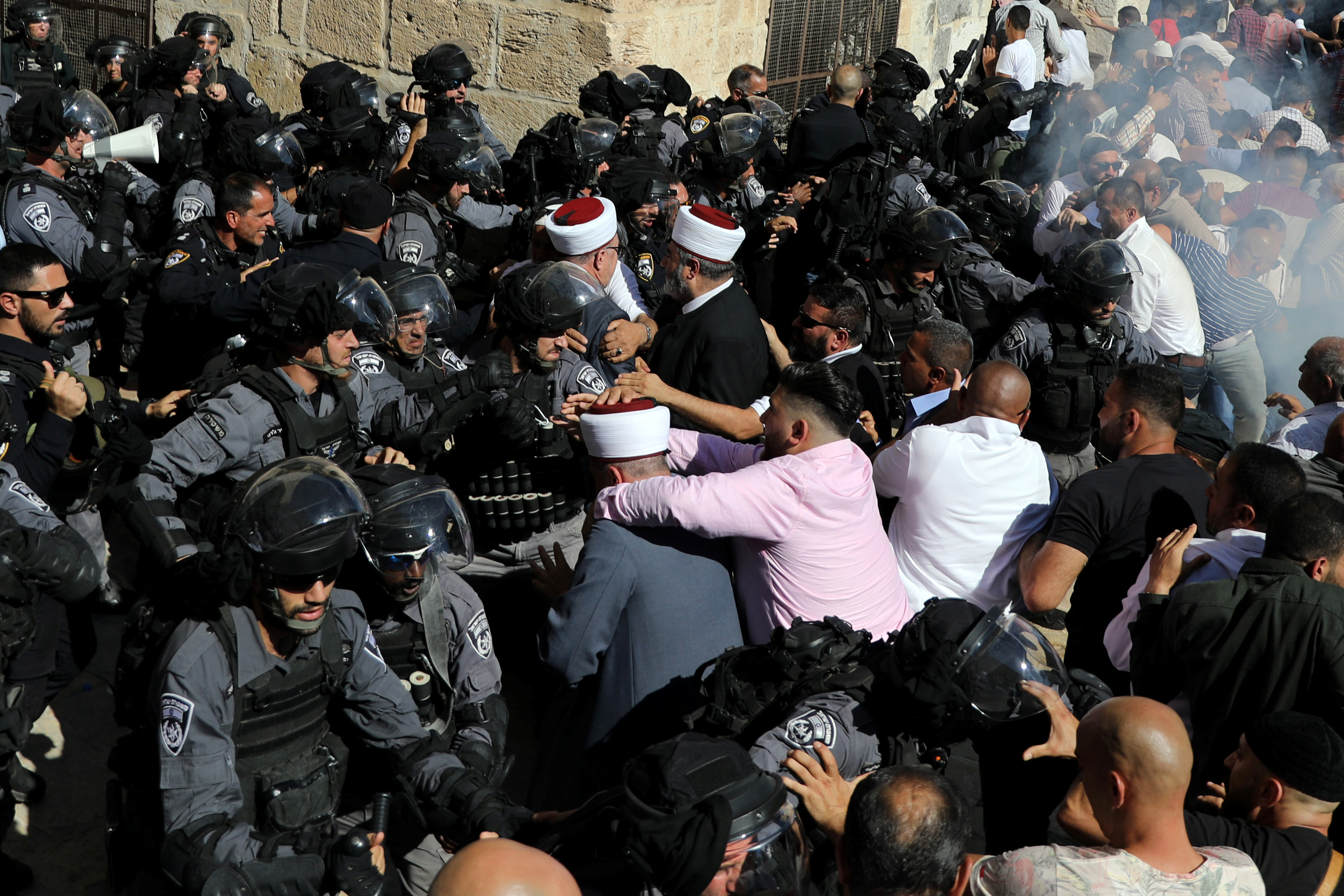Israeli police clash with Palestinian worshippers on the compound known to Muslims as Noble Sanctuary and to Jews as Temple Mount as Muslims mark Eid al-Adha, in Jerusalem's Old City
