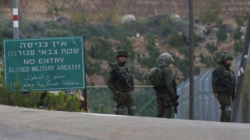 israeli_soldiers_block_the_road_on_the_border_with_lebanon_in_the_northern_town_of_metula_december_4_2018._ap