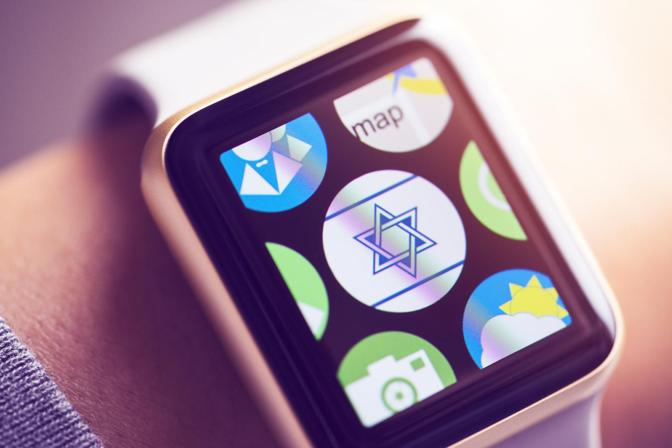 Jewish app icon on smart watch screen.