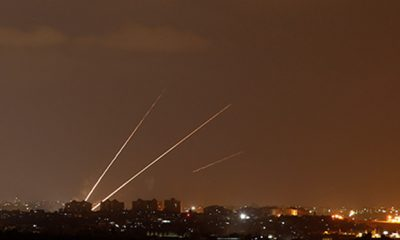 Streaks of light are pictured as rockets are launched from the northern Gaza Strip towards Israel, as seen from Sderot