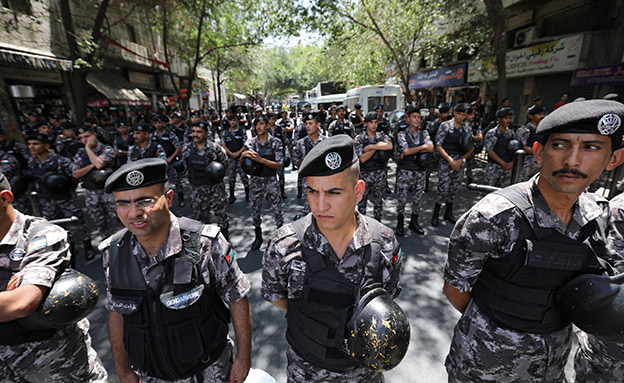 """Jordanian police stand guard during a protest against Trump's """"Deal of the Century"""", after Friday prayers in Amman"""