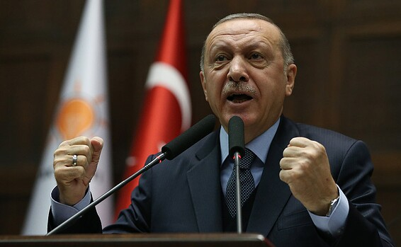 Turkish President Recep Tayyip Erdogan addresses members of ruling AKP