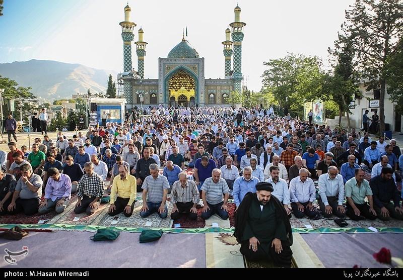 Iranians_holding_Eid_al-Fitr_prayer_in_Lavizan_Imamzadeh_shrine,_Tehran,_Iran