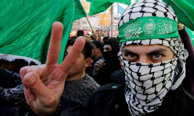 Palestinian Hamas supporter gestures during a rally marking the 31st anniversary of Hamas' founding, in Nablus in the Israeli-occupied West Bank