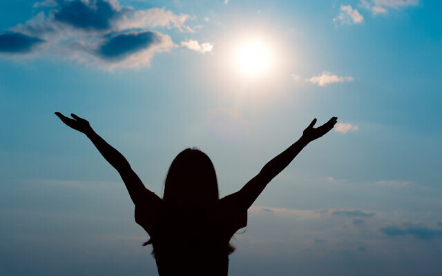 Happy Girl Raising Arms Looking at The Sun