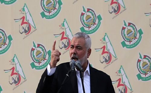 Hamas Chief Ismail Haniyeh gestures as he speaks during a rally marking the 31st anniversary of Hamas' founding, in Gaza City