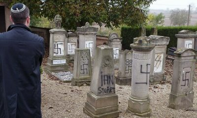 A member of the Jewish community inspects tombstones desecrated by vandals in a cemetery in Brumath …