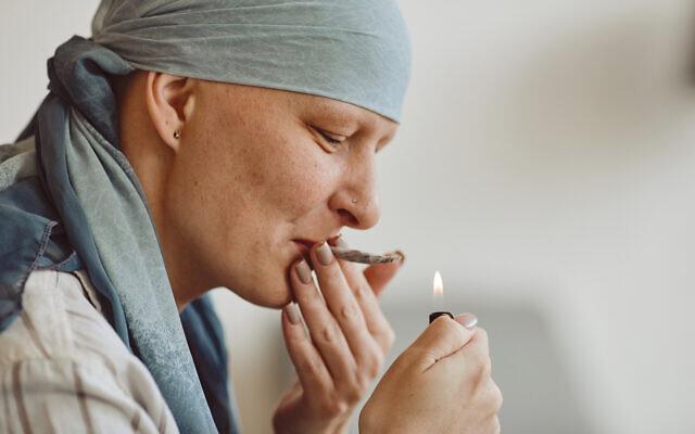 Bald Woman Smoking Marijuana