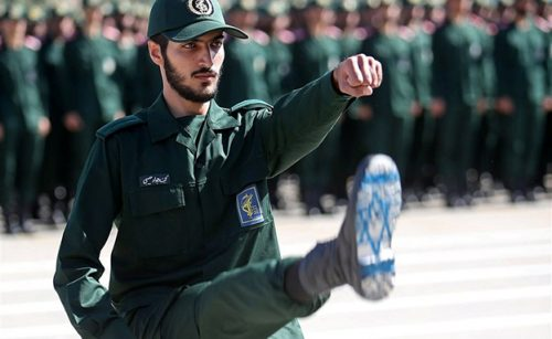 An Iranian Officer of Revolutionary Guards, with Israel flag drawn on his boots, is seen during graduation ceremony, held for the military cadets in a military academy, in Tehran