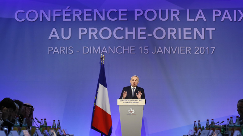 French Minister of Foreign Affairs Jean-Marc Ayrault addresses delegates at the opening of the Mideast peace conference in Paris