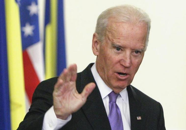 U.S. Vice President Biden gestures at a news conference with Ukraine's President Poroshenko in Kiev