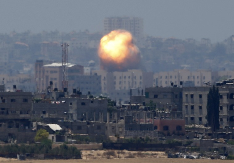 An explosion is seen after an air strike in northern Gaza